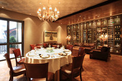 Dining room. Round table in Spacious Dining Room Royalty Free Stock Photo