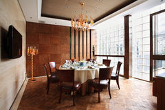 Dining room. Round table in Spacious Dining Room Royalty Free Stock Images