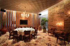 Dining room. Round table in Spacious Dining Room Stock Image