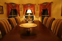 Dining Room. Yellow dining room with red curtains Stock Photography