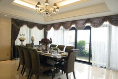 Dining room. In the luxury house with large windows Royalty Free Stock Photo