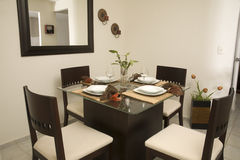 Dining room. Small dining room with four charis Stock Photos