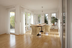 Dining Room. Interior shot of a dining room with lots of windows and garden view Royalty Free Stock Images