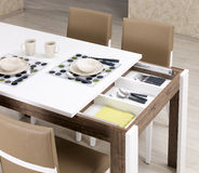 Dining room. A modern dining room table Stock Images