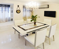 Dining room. Modern dining room with luxurious decoration Royalty Free Stock Images