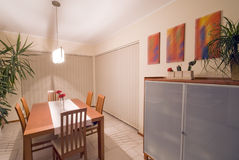 Dining room. Elegant and simple dining room. Modern home interior Royalty Free Stock Photo
