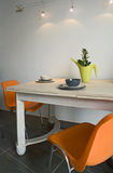 Dining room. With orange chairs Stock Image