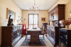 Dining room with antiquities in home interior Stock Photo