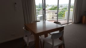 A very comfortable dining area in my lovely apartment at the Alpha Sovereign Resort, Surfers Paradise, Queensland stock images