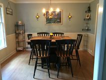 Dining room with bar height table and original oil painting. Dining room with original oil painting and bar height table and chairs - black scroll Royalty Free Stock Images