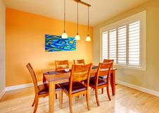 Dining room with blue painting and wood table. Stock Photos