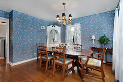 Dining room with blue wallpaper Royalty Free Stock Images