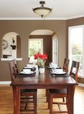 Dining room with brown walls and wood table. Royalty Free Stock Image