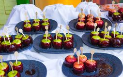 Food at a cruise ship. Dining Room Buffet aboard the abstract luxury cruise ship. Cakes from apples Royalty Free Stock Photo