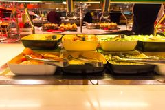 Dining Room Buffet aboard the luxury abstract cruise ship. Dining Room Buffet aboard the abstract luxury cruise ship. Selective focus. Burgers Stock Photo