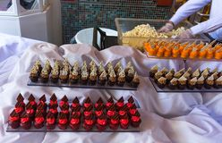 Food at a cruise ship. Dining Room Buffet aboard the abstract luxury cruise ship. Selective focus. Cakes Stock Images