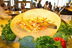 Dining Room Buffet aboard the luxury abstract cruise ship. Dining Room Buffet aboard the abstract luxury cruise ship. Selective focus. vegetable dishes. shrimp Royalty Free Stock Photo
