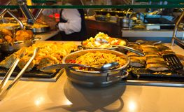 Dining Room Buffet aboard the luxury abstract cruise ship. Dining Room Buffet aboard the abstract luxury cruise ship. Selective focus. vegetable dishes. fish and Royalty Free Stock Image