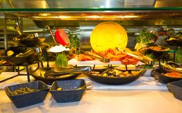 Dining Room Buffet aboard the luxury abstract cruise ship. Dining Room Buffet aboard the abstract luxury cruise ship. Selective focus. vegetable dishes. meat Stock Images
