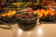 Dining Room Buffet aboard the luxury abstract cruise ship. Dining Room Buffet aboard the abstract luxury cruise ship. Selective focus. Burgers Royalty Free Stock Image