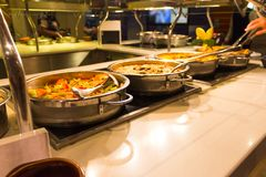 Dining Room Buffet aboard the luxury abstract cruise ship. Dining Room Buffet aboard the abstract luxury cruise ship. Selective focus. vegetable dishes Stock Photography