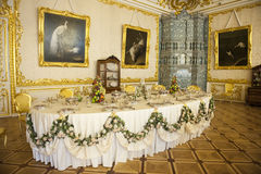 Dining Room Catherine Palace, St. Petersburg. Well layed table inside the Catherine Palace, Pushkin near St. Petersburg, Russia Royalty Free Stock Image
