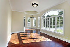 Dining room with cherry wood flooring royalty free stock image