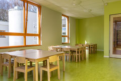 Dining room for children in kindergarten stock photography