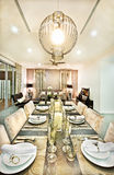 Dining room close up with chairs and glasses at night Royalty Free Stock Photo