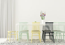 Dining room with colored chairs Stock Images
