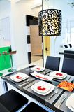 Dining room in a condominium stock photos