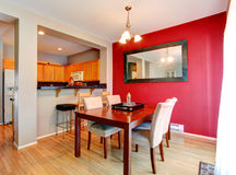 Dining room with contrast red wall Royalty Free Stock Photo