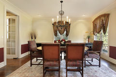 Dining room with cream colored walls Royalty Free Stock Photography