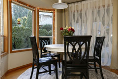 Dining room with curved window wall Stock Photo