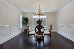 Dining room with dark wood flooring Stock Photo