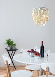 Dining room decorated with beautiful chandelier Stock Photo