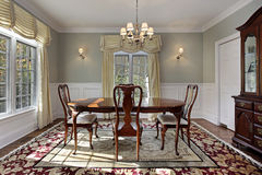 Dining room with decorative rug Stock Photos