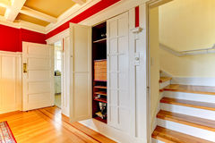 Dining room detailes with closet and staircase. Royalty Free Stock Image