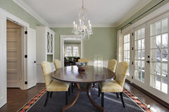 Dining room with doors to deck stock photos