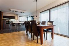 Dining room in elegant flat Stock Images