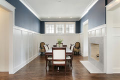Dining room with fireplace. Dining room in new construction home with fireplace Royalty Free Stock Images