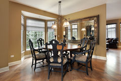 Dining room with gold walls Stock Images