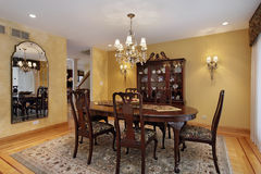 Dining room with gold walls Royalty Free Stock Photo