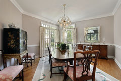 Dining room with gray carpet. Dining room in luxury home with gray carpet royalty free stock image