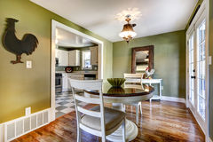 Dining room in green tones with exit to backyard Stock Images