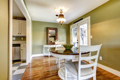 Dining room in green tones with exit to backyard Stock Photography