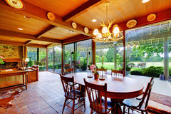 Dining room with green view and windows wall stock image