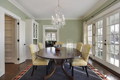 Dining room with green walls Stock Photography