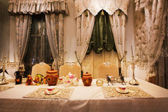 Dining room. The dining room is an important part of the family, the style of Chinese and European style, the picture shows the European style Royalty Free Stock Photo