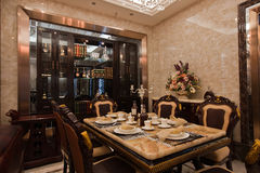 Dining room. The dining room is an important part of the family, the style of Chinese and European style, the picture shows the European style Royalty Free Stock Photos